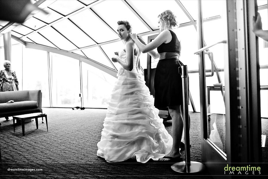 bride putting on dress in denver