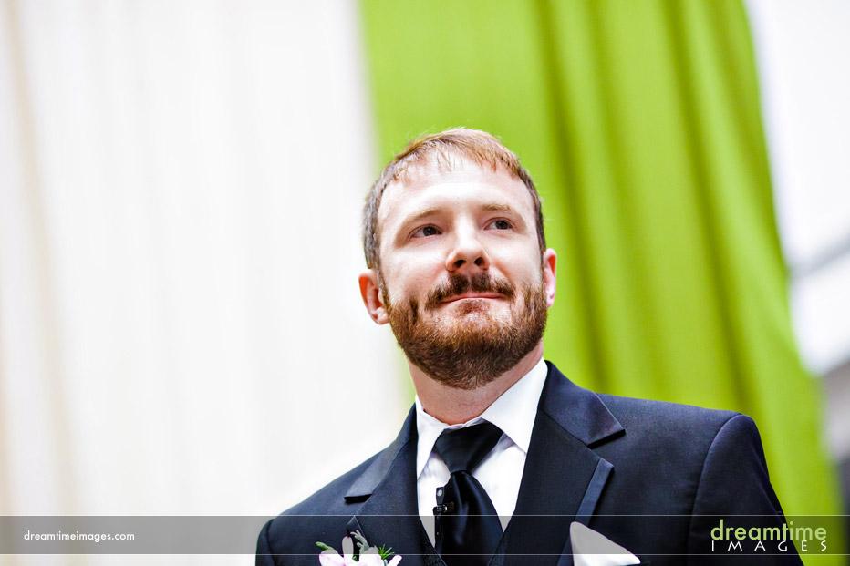 groom watching bride enter in denver