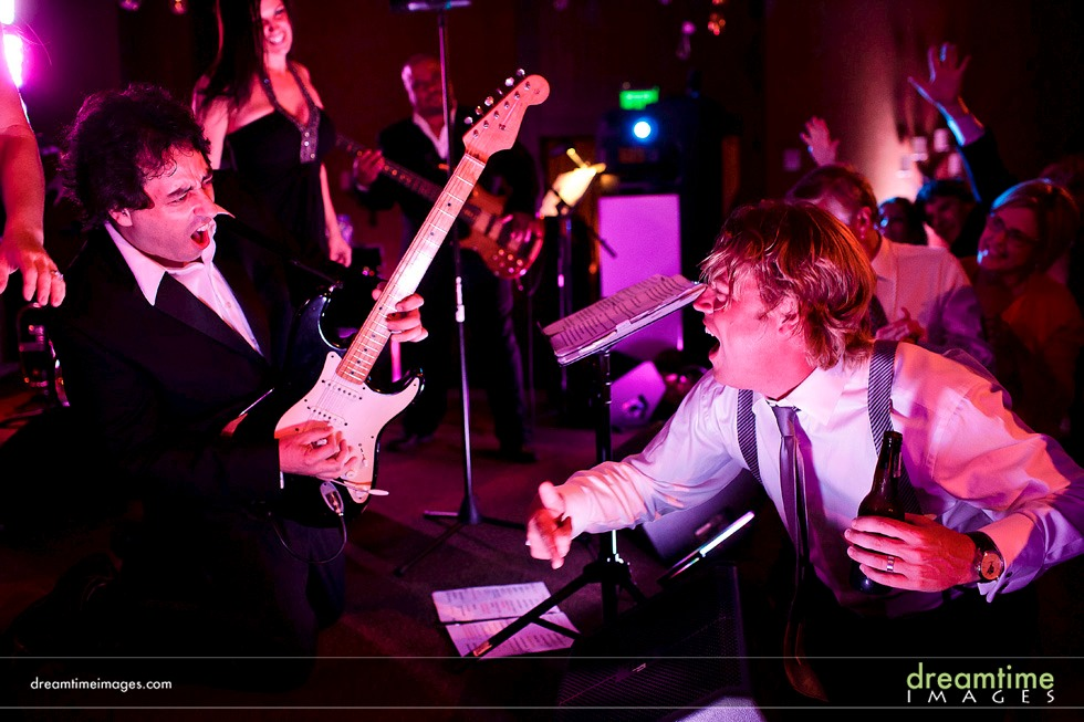 groom and guitarist