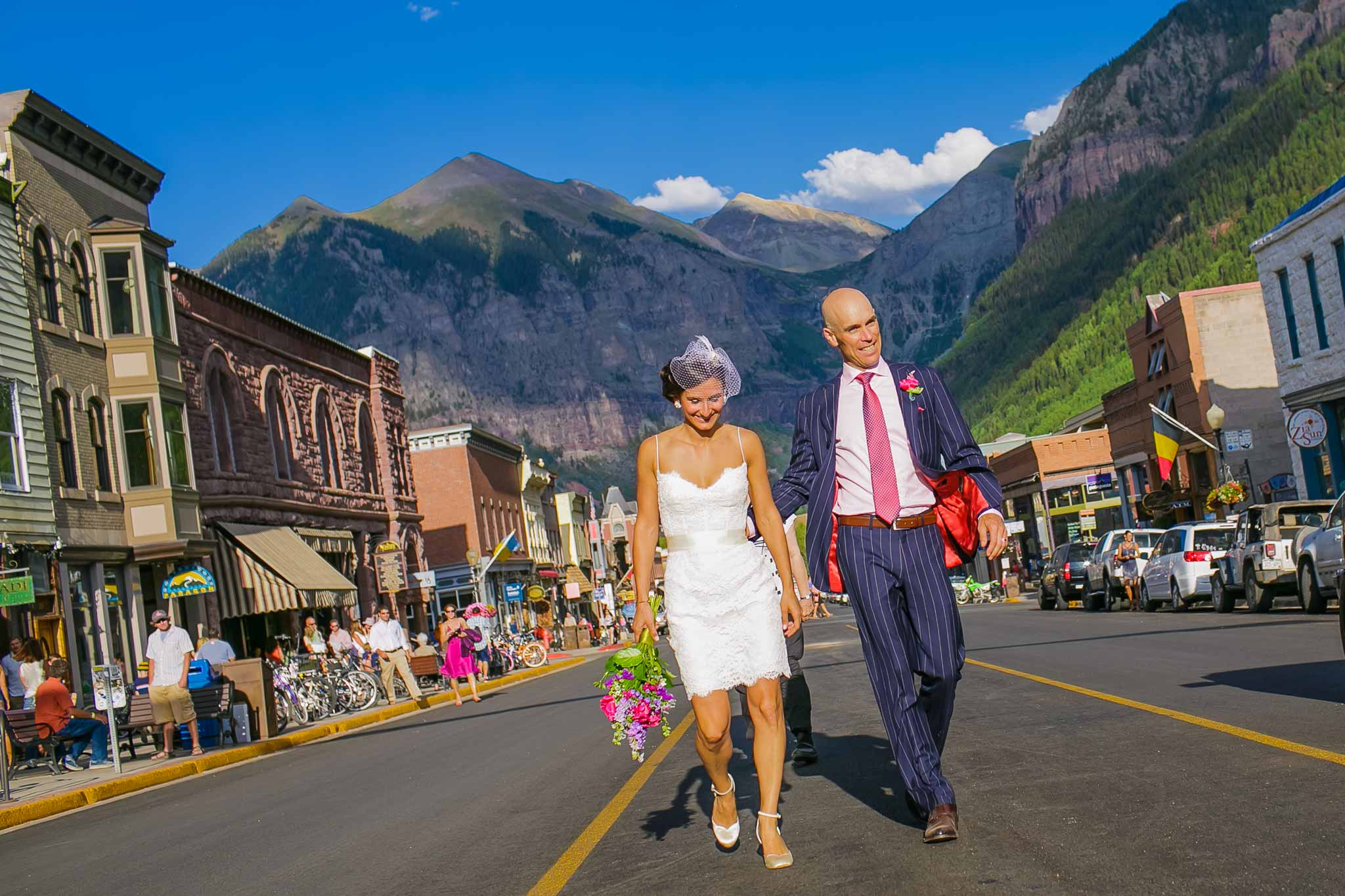 Bride and groom in front of New Sheridan Hotel in Telluride