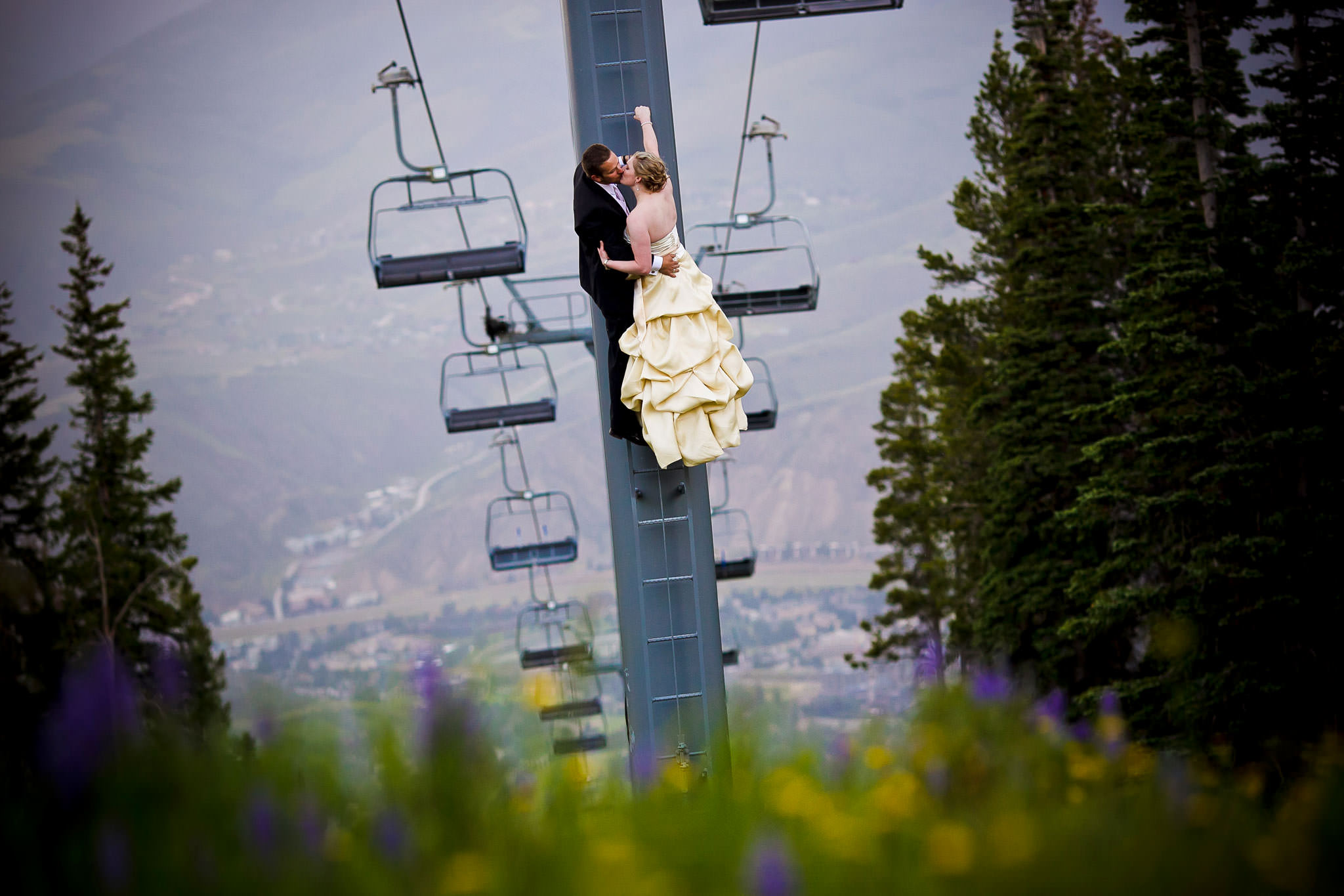 A wedding couple on the chair lift at Beaver Creek Mountain