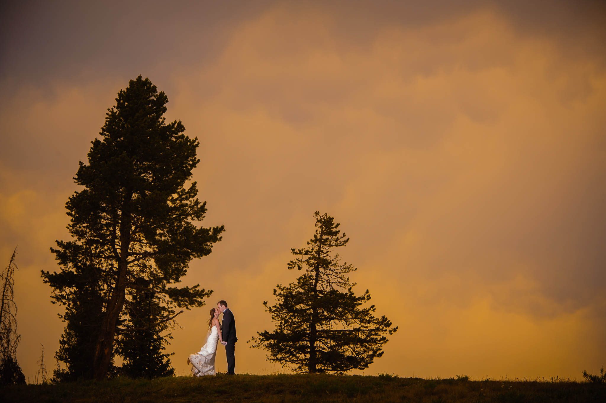 Bride and groom at sunset near the Vail Wedding Deck