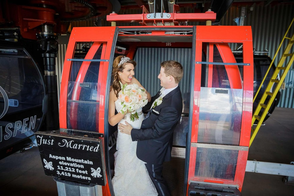 Photo of a bride and groom on the Aspen Mountain gondola