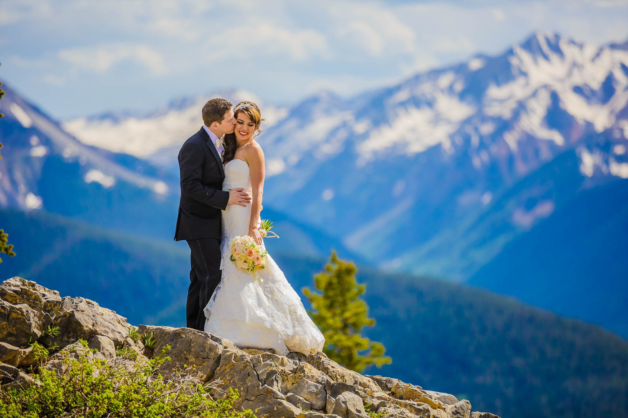 Photo of a wedding couple on Aspen Mountain, next to the Aspen Mountain Club and the Little Nell