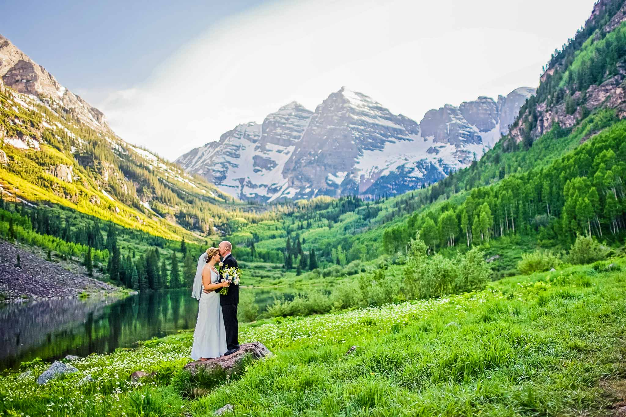 Bride and groom in front of the Maroon Bells