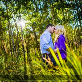 Couple kissing in aspen grove