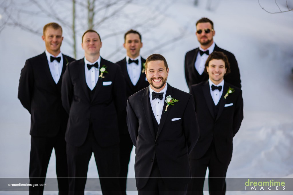 Groom and groomsmen in snow at Saddleridge