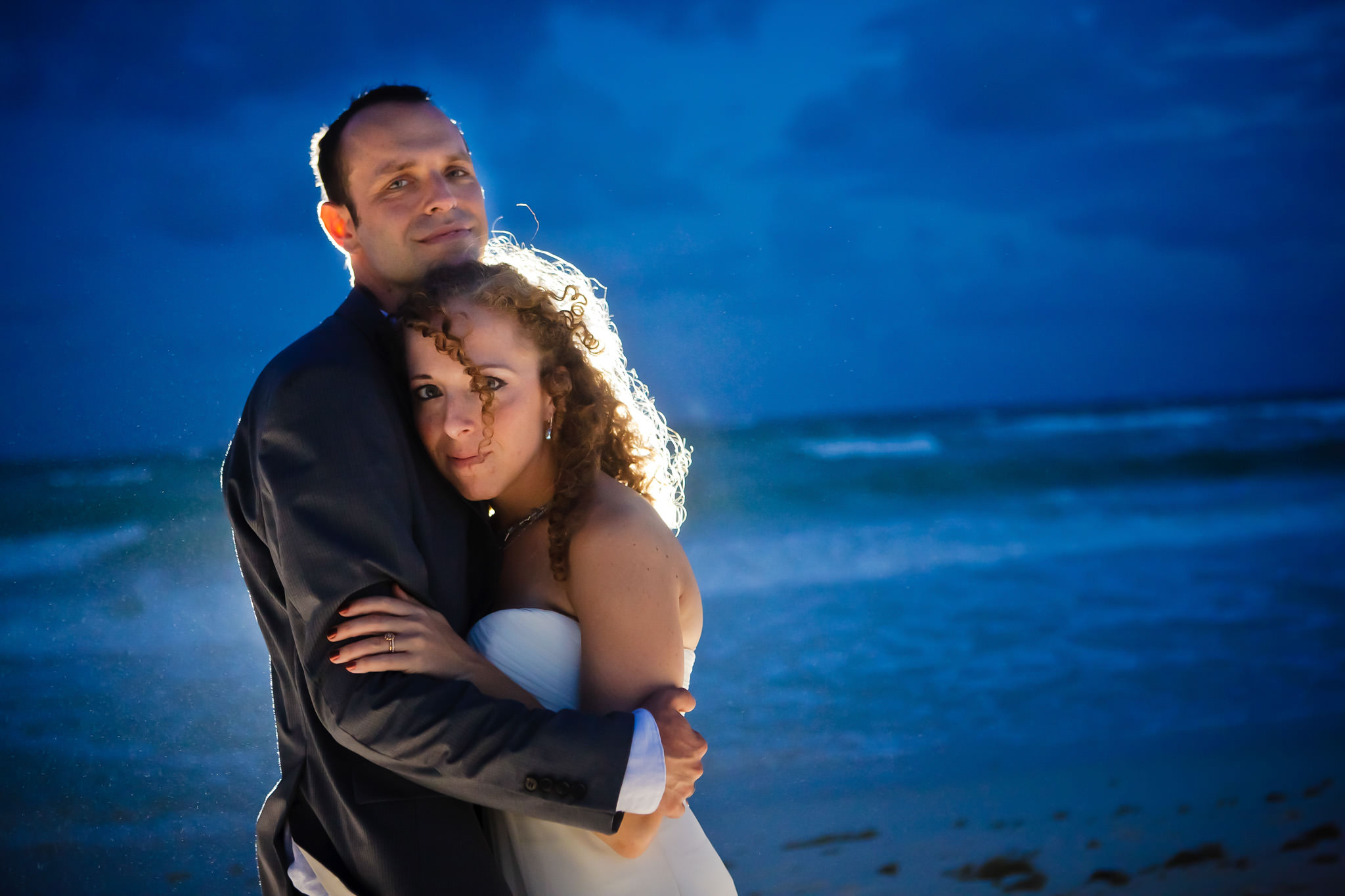 Bride and groom on beach near Playa del Carmen