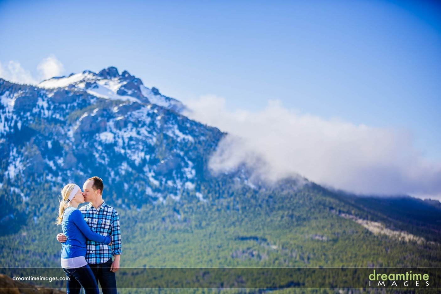 Couple kissing after wedding proposal