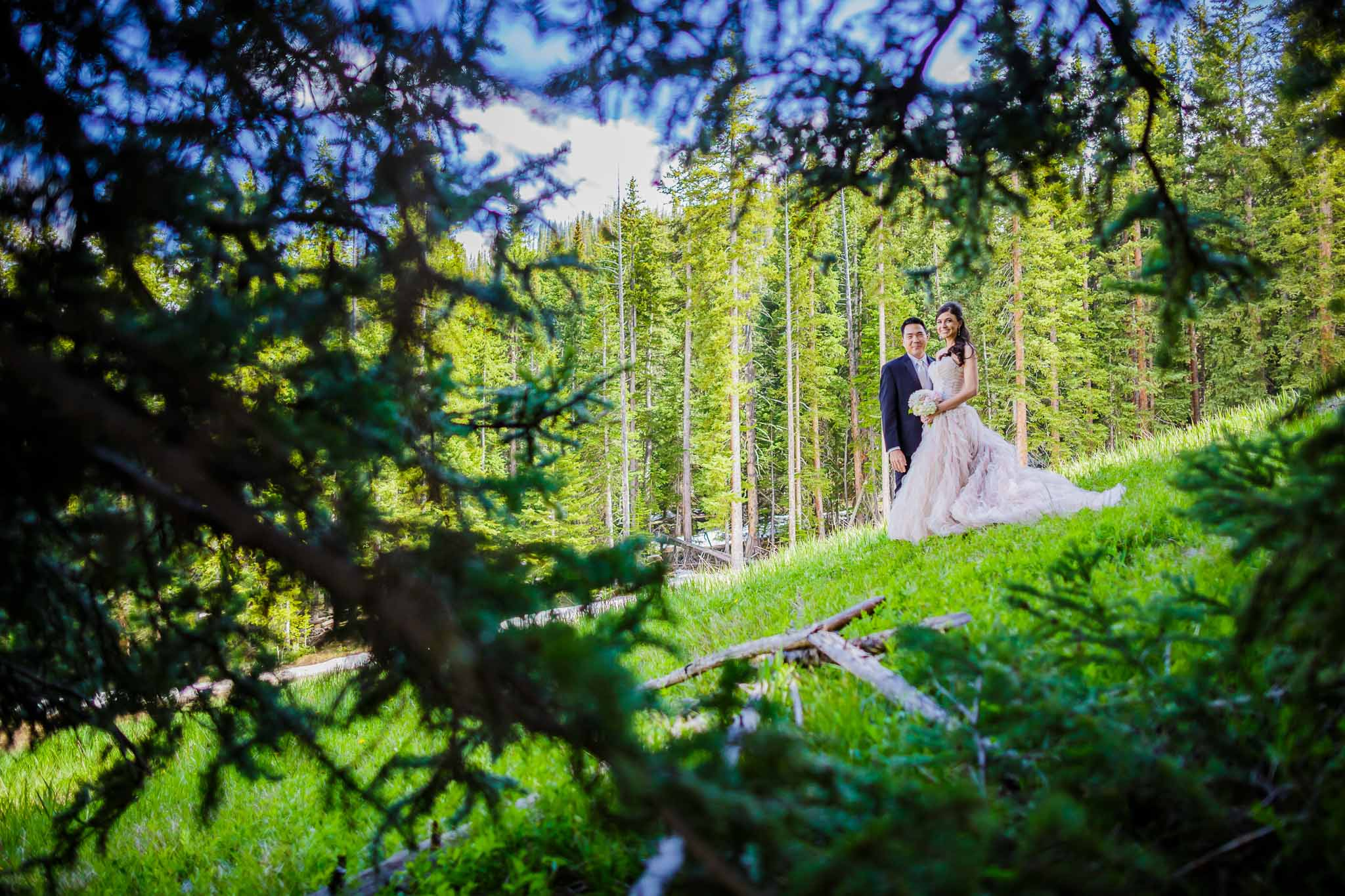 Image of bride and groom from in forest near Beaver Creek Wedding Deck