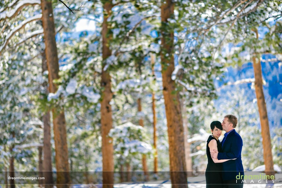 Snowy engagement picture in Estes Park