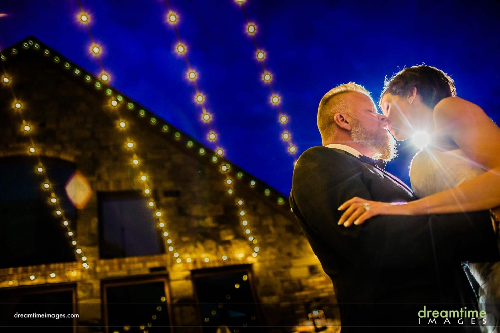 Bride and Groom Kissing near Della Terra Mountain Chateau