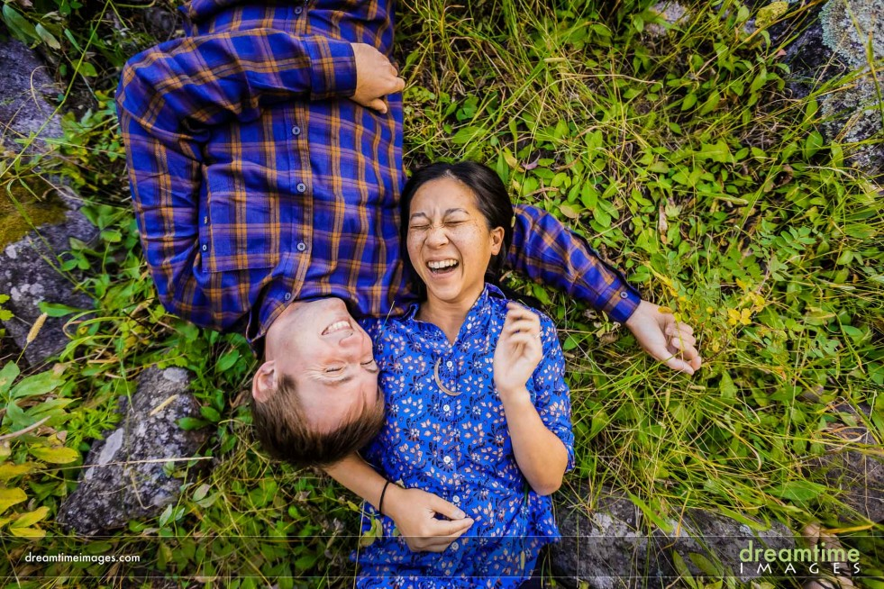 Enagement photo of couple laughing