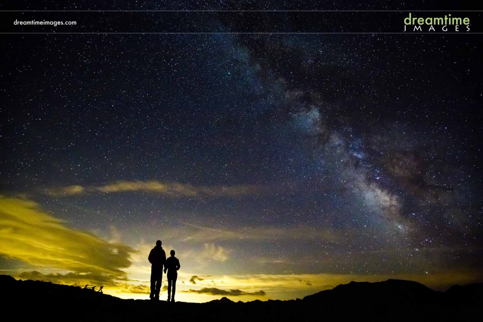 Engagement picture at night with Milky Way