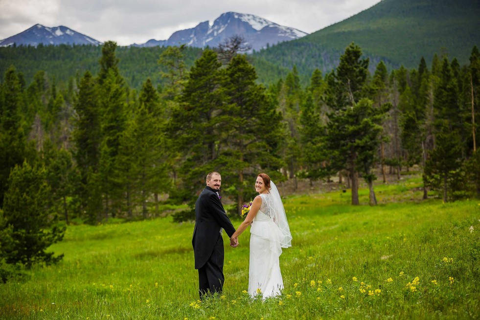 Wedding photo at Lily Lake with Longs Peak views in RMNP