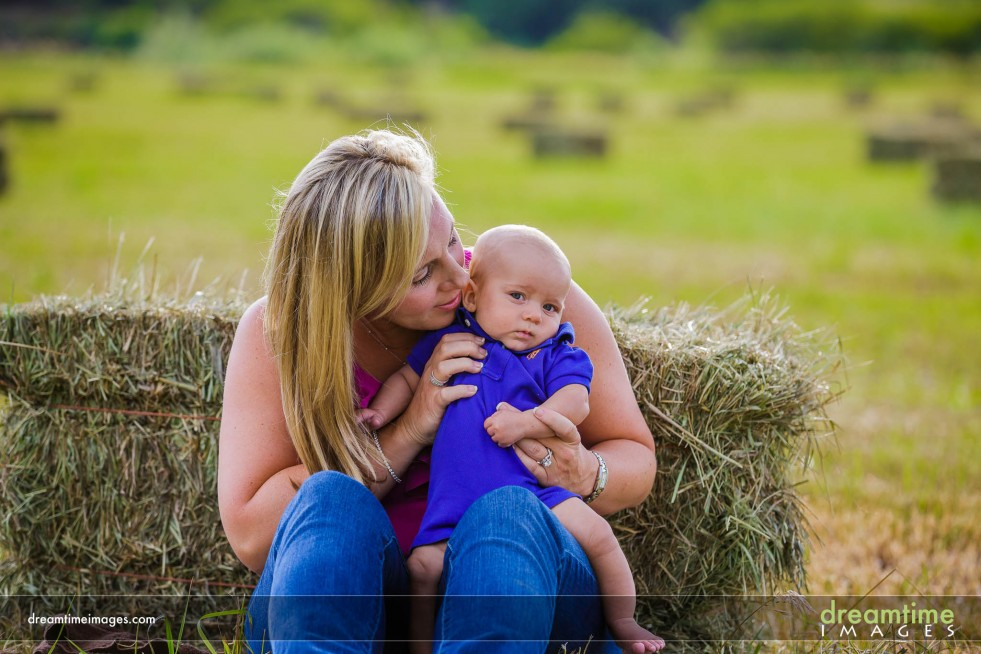 A mom and her child on a hay bale on the Western Slope of CO