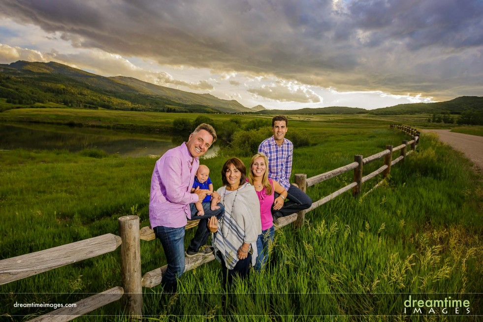 Three generations of family members pose for a family portrait near Snowmass