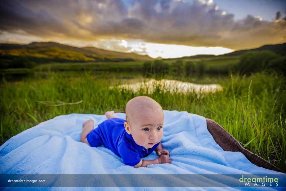 An infant on a blanket at sunset near Aspen, CO