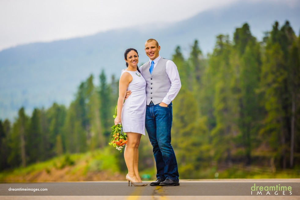 A bride and groom on Highway 7 in Allenspark