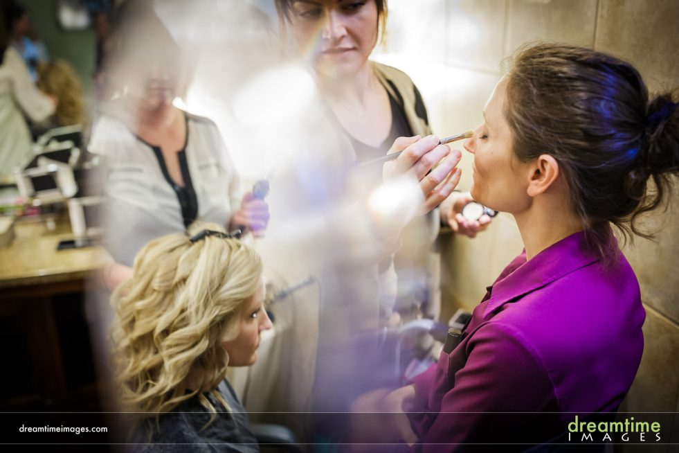 Bride doing makeup at Della Terra