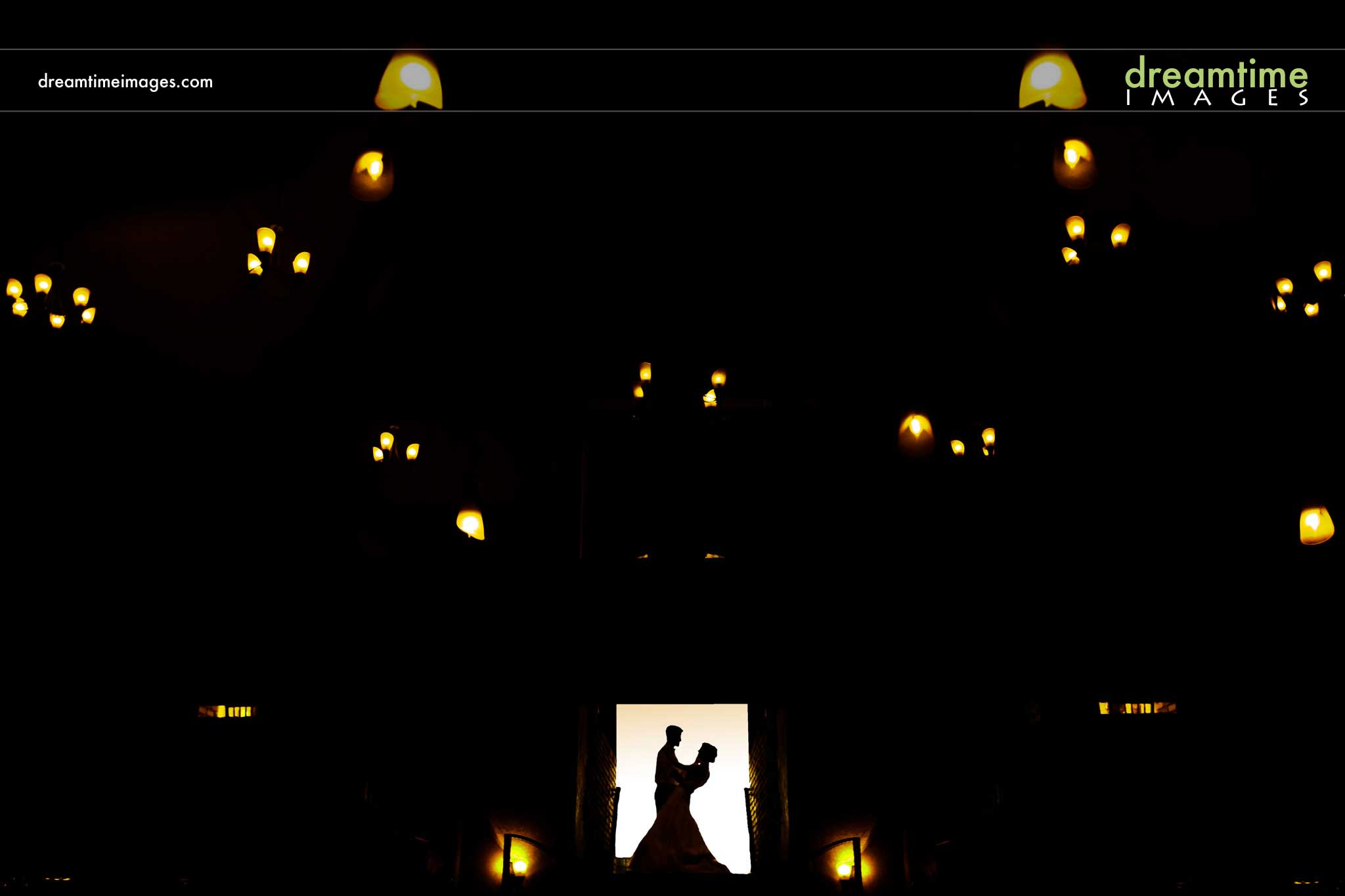 Bride and groom dancing in the lights at Della Terra Mountain Chateau