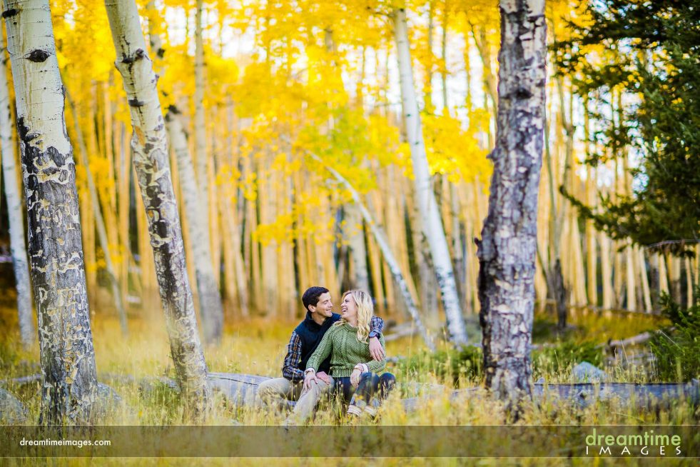 engaged couple in fall in rmnp