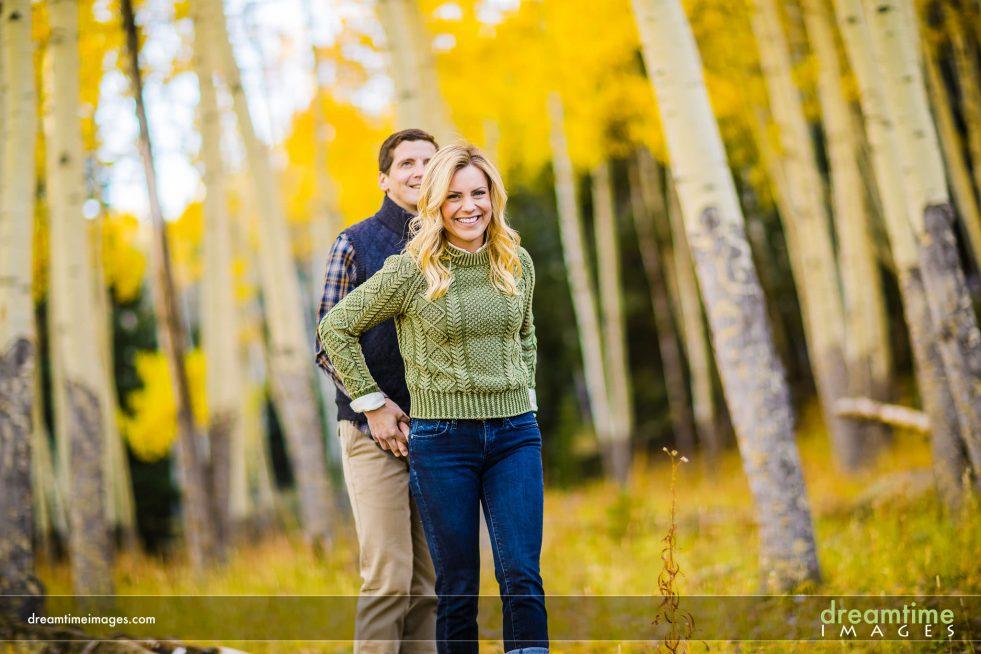 couple walking through aspen grove