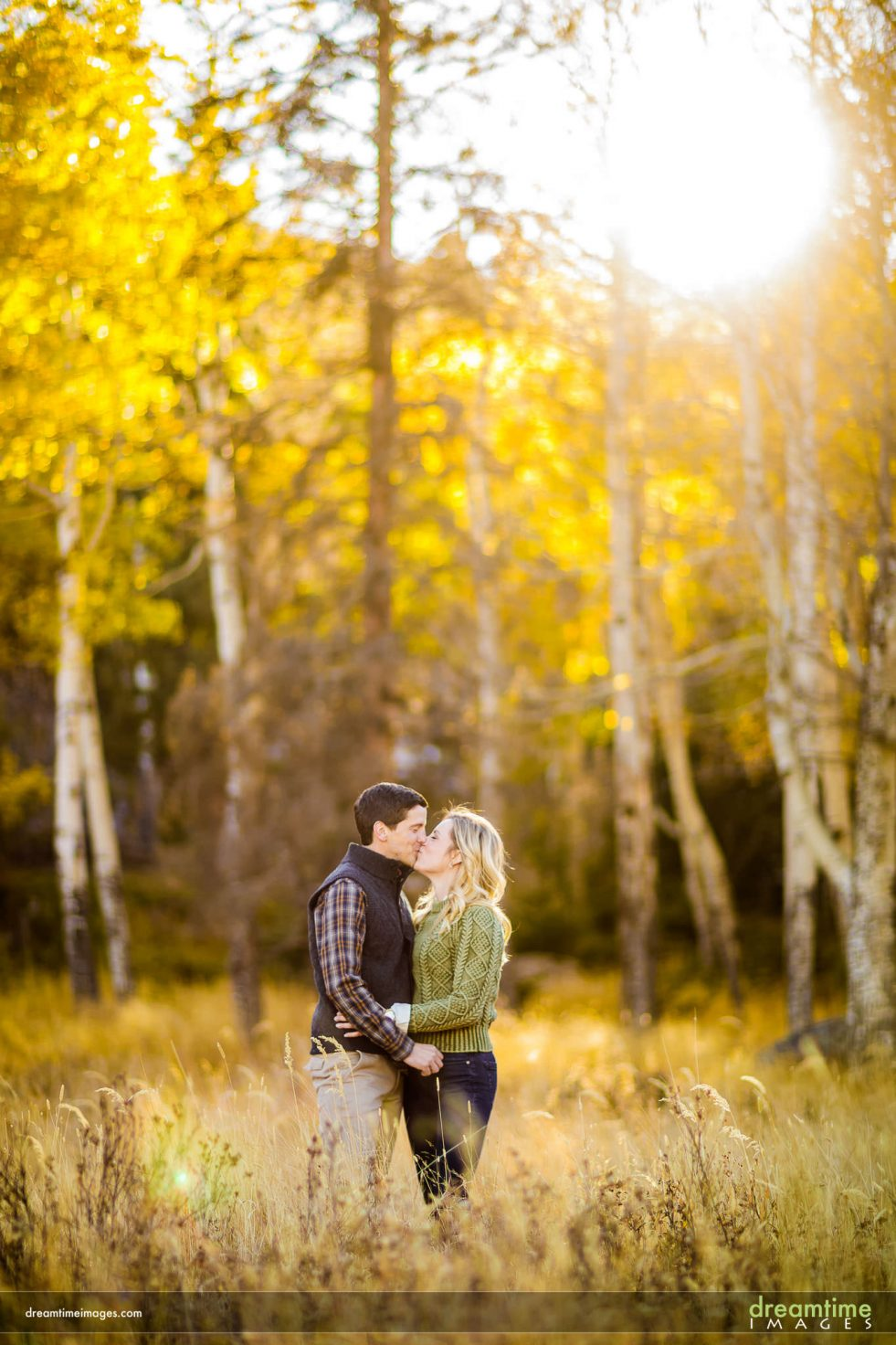 Backlit photo of engaged couple in fall in Colorado
