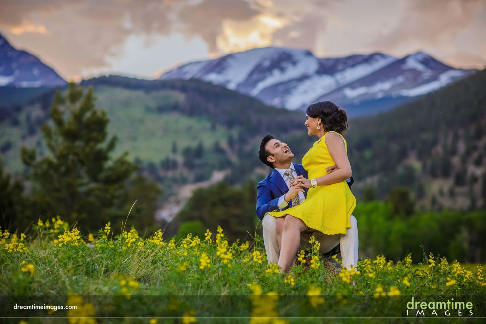 engaged couple playing in rmnp