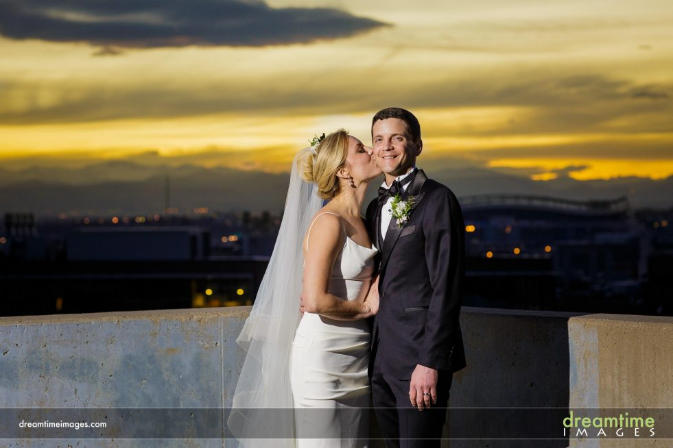 wedding portrait on top of denver performing arts complex