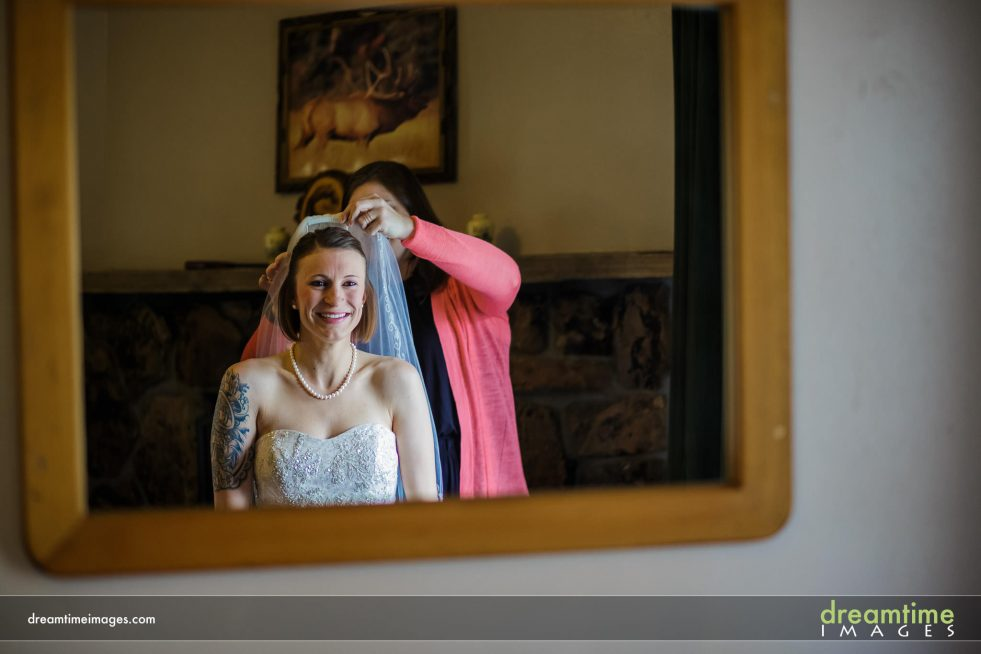 Bride in mirror in estes park