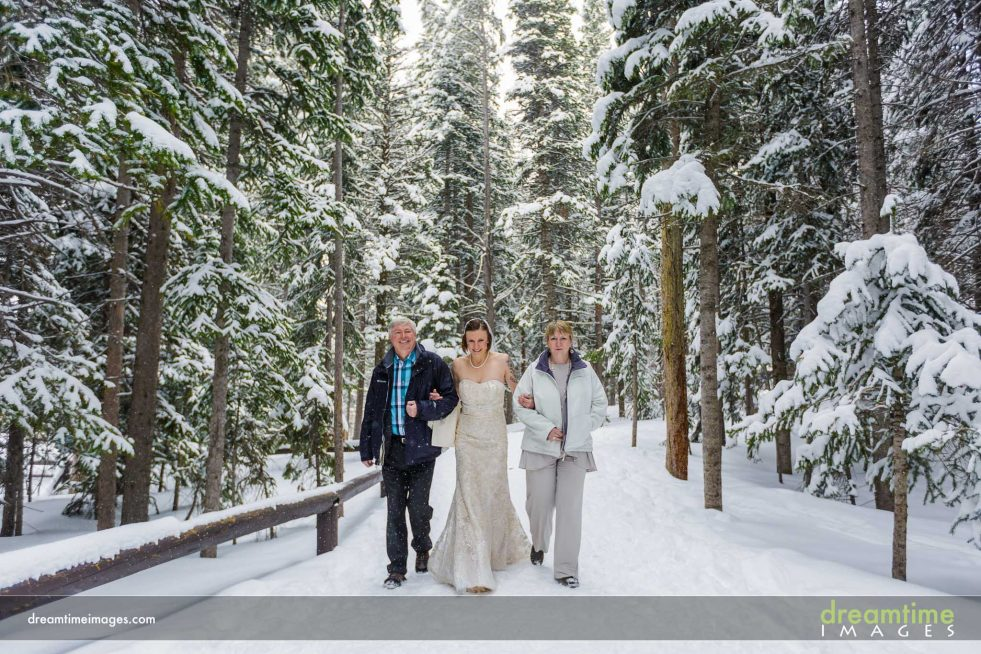 Bride walking to ceremony in Rocky Mountain National Park